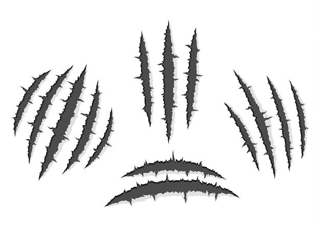 괴물 발톱, 손 긁힘 또는 그림자와 빛이있는 흰색 배경을 통해 찢어짐 세트 프리미엄 벡터