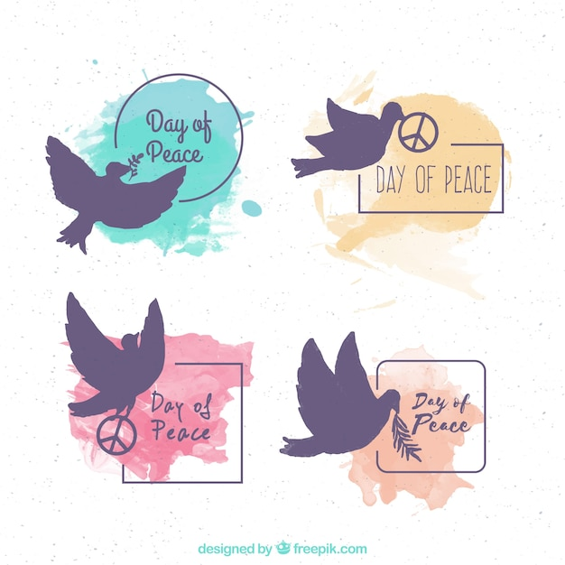 Set of peace day stickers with dove silhouettes and watercolor stains Free Vector