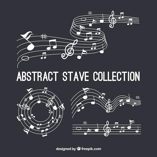Набор пентаграмм и музыкальных нот Бесплатные векторы