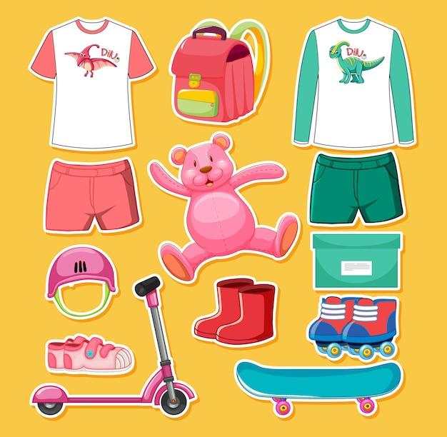 分離されたピンクと緑の色のおもちゃと服のセット 無料ベクター