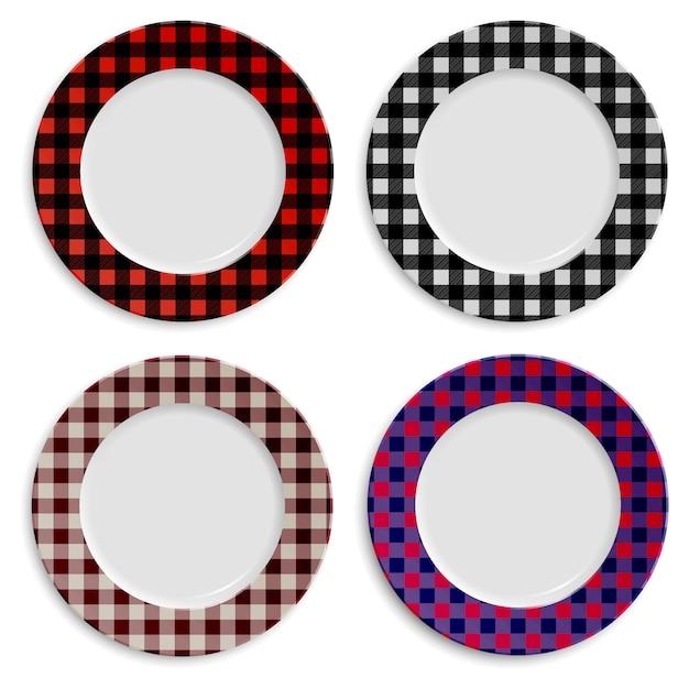 Набор тарелок с клетчатым узором на белом Premium векторы