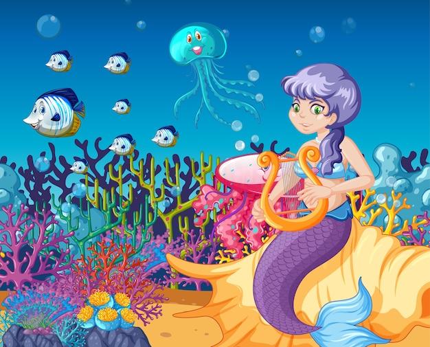 海の動物と海の背景に人魚漫画のセット Premiumベクター