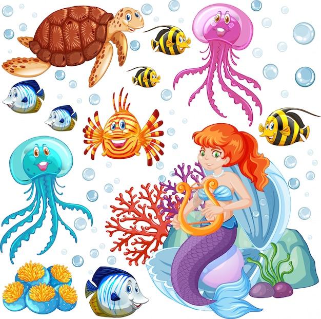 海の動物と白い背景の上の人魚の漫画のスタイルのセット 無料ベクター