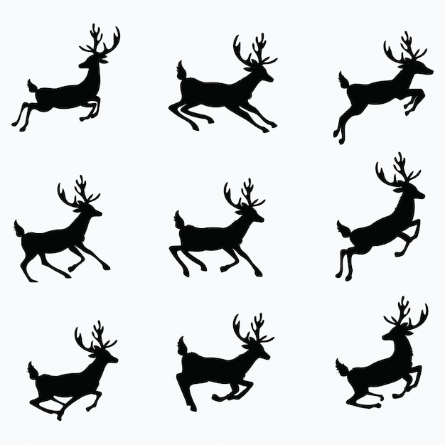 実行中の鹿のシルエットのセット。クリスマスの鹿のコレクション。図。 Premiumベクター