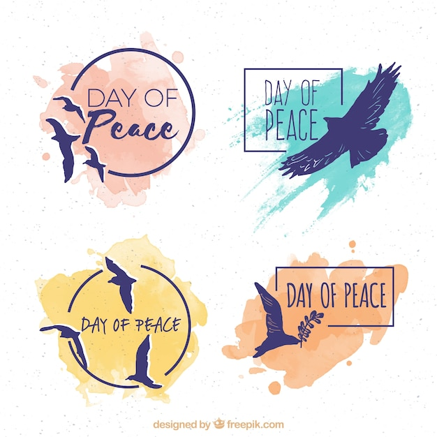 Set of silhouettes stickers of doves with watercolor stains Free Vector