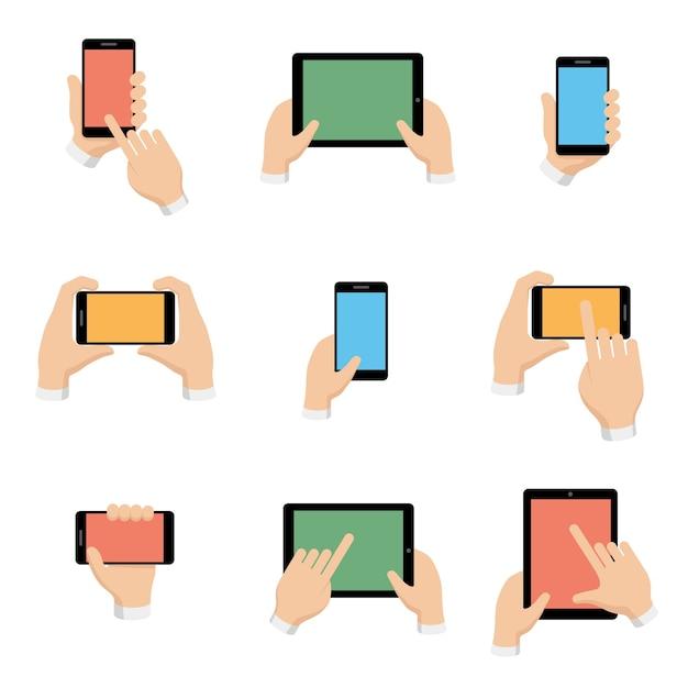평면 디자인 스타일에 손에 스마트 폰 및 태블릿의 집합입니다. 무료 벡터