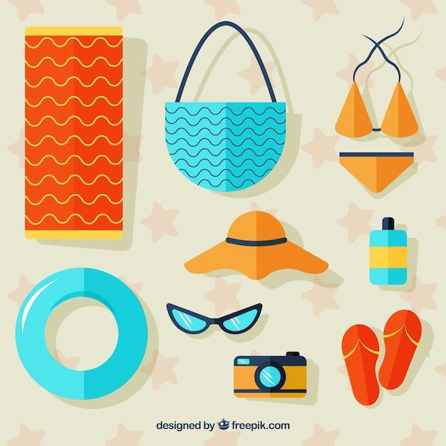 フラットスタイルの衣服と夏の要素のセット 無料ベクター
