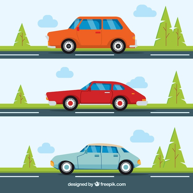Set of three cars on the road Free Vector