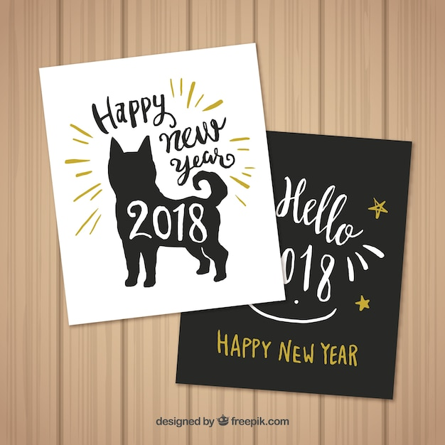 set of two hand drawn new year cards with a dog free vector
