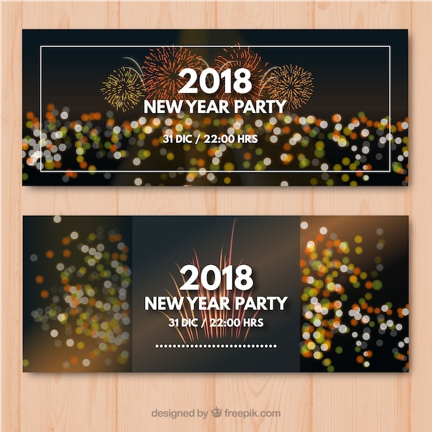 Set of two new year party banners with bokeh effect Free Vector