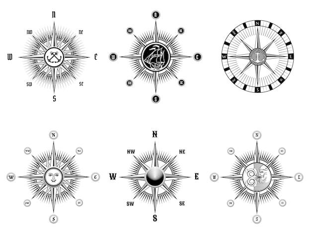 ヴィンテージの航海または海洋コンパスアイコンのセットは、白い背景に黒い線を描画します。 無料ベクター