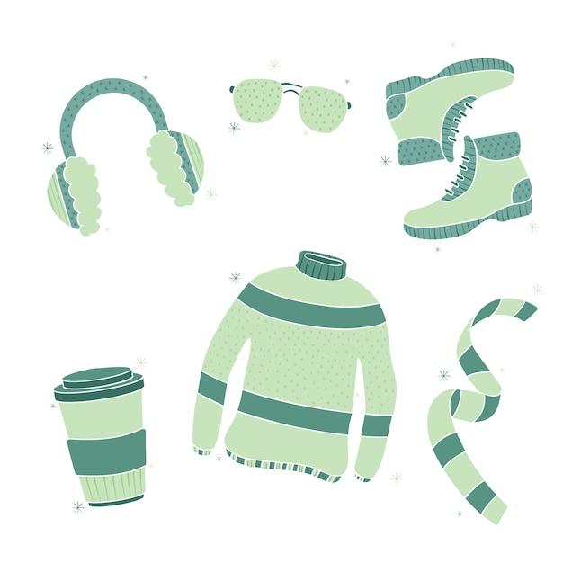 Набор теплой зимней одежды рисованной Бесплатные векторы