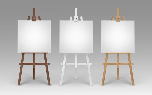 Набор деревянных коричневых белых мольбертов сиены с пустыми пустыми квадратными холстами на фоне Premium векторы