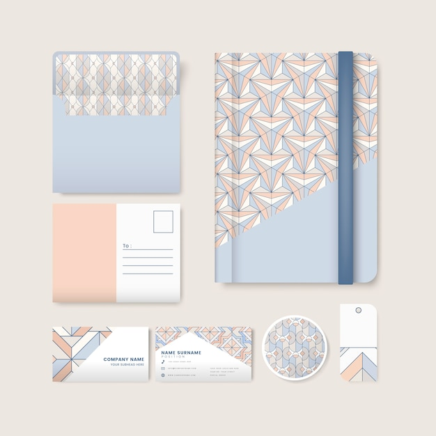 Set of pastel geometric pattern on blue surface stationery Free Vector
