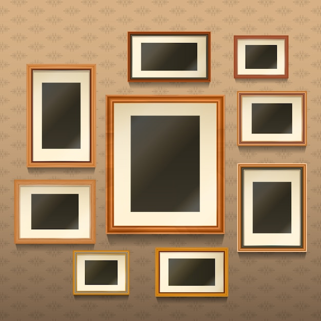 Set of realistic empty picture frames on wall Free Vector