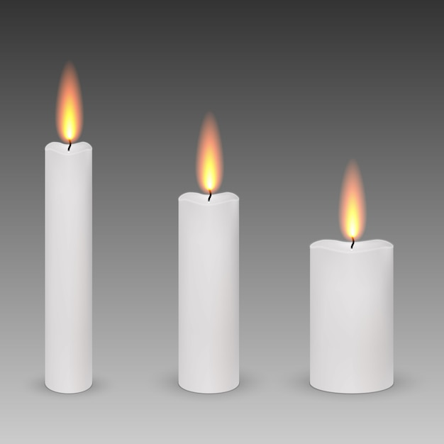 Set of realistic paraffin burning candles isolated Premium Vector