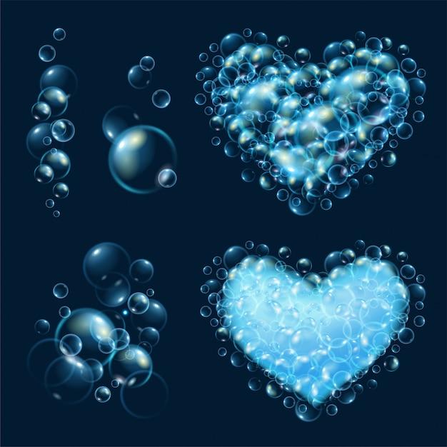 Set of realistic water bubbles. Premium Vector