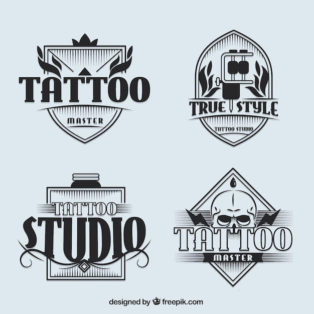 Set of tattoo studio logotypes in vintage style Free Vector