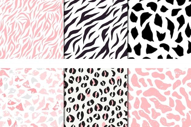 Set of vector seamless patterns, leopard, zebra, pebble giraffe Premium Vector
