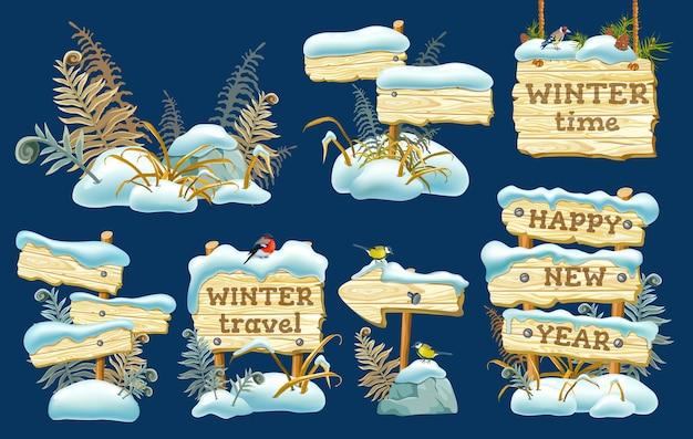 Set di tavole di legno con cumulo di neve. Vettore gratuito