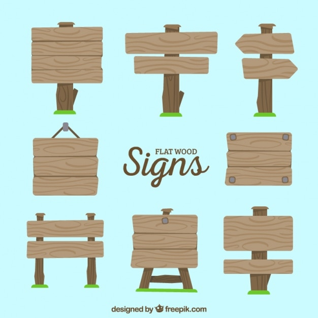 Set of wooden signs with grass in flat style Free Vector