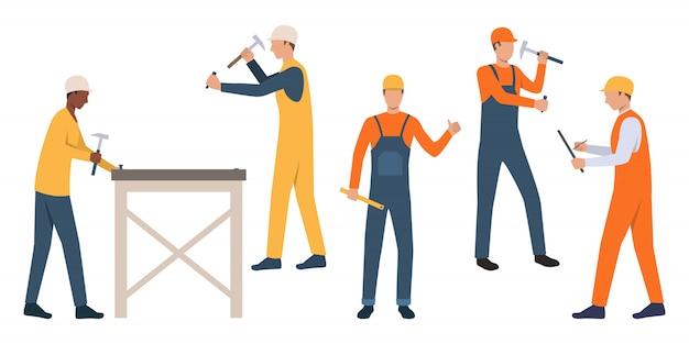 Set of workmen in hardhats Free Vector