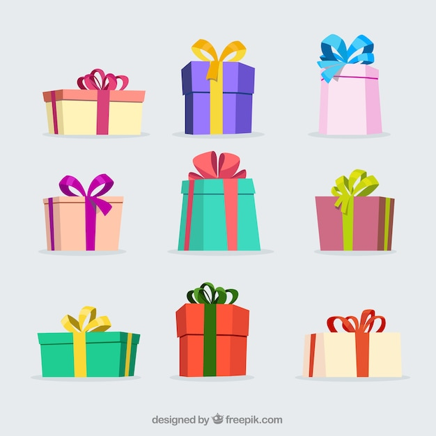 Several colored christmas gifts Free Vector