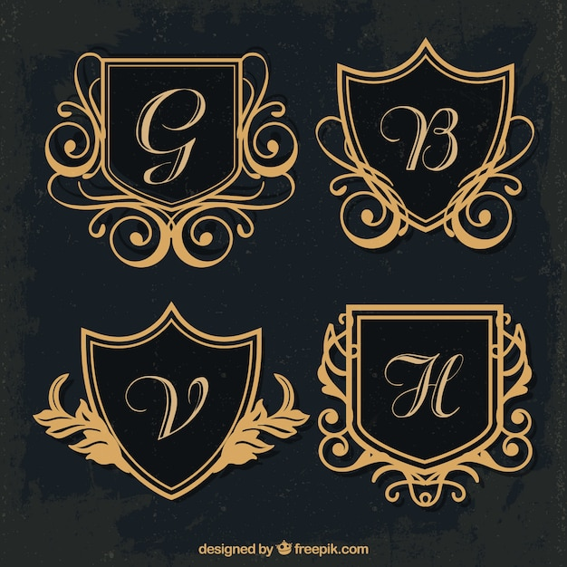 Several golden shield monograms Free Vector