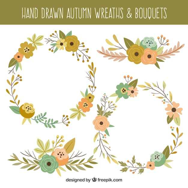 Several hand-drawn autumn wreaths and floral details Free Vector