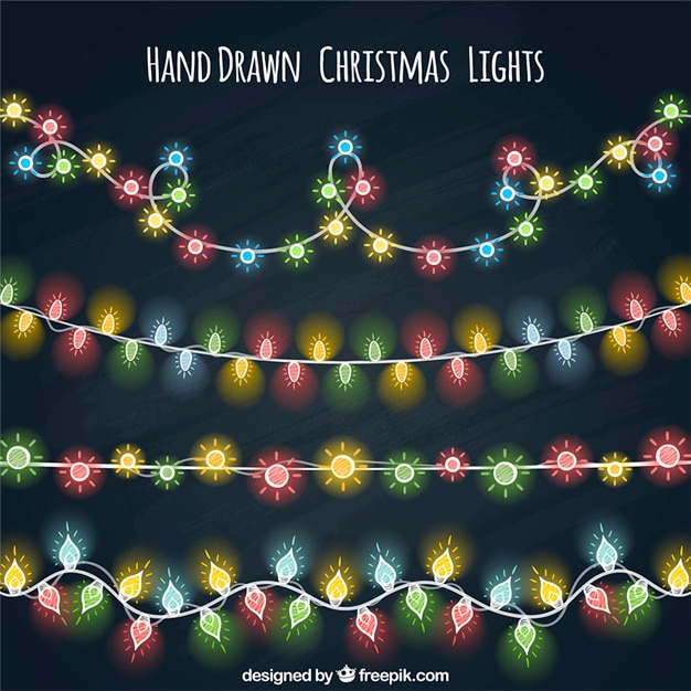 Several hand drawn colored string ligths Free Vector