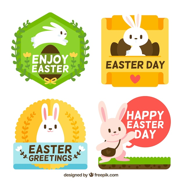 Several pretty stickers of easter bunnies in flat design Free Vector