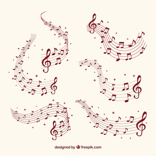 Several staves with musical notes Free Vector