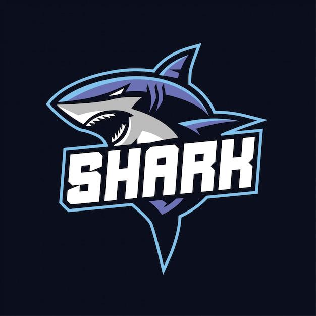 暗い背景に分離されたスポーツとeスポーツのロゴのサメマスコット Premiumベクター