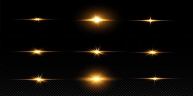 Сияющие золотые звезды, изолированные на черном фоне. эффекты, блики, линии, блеск, взрыв, золотой свет. векторная иллюстрация Premium векторы