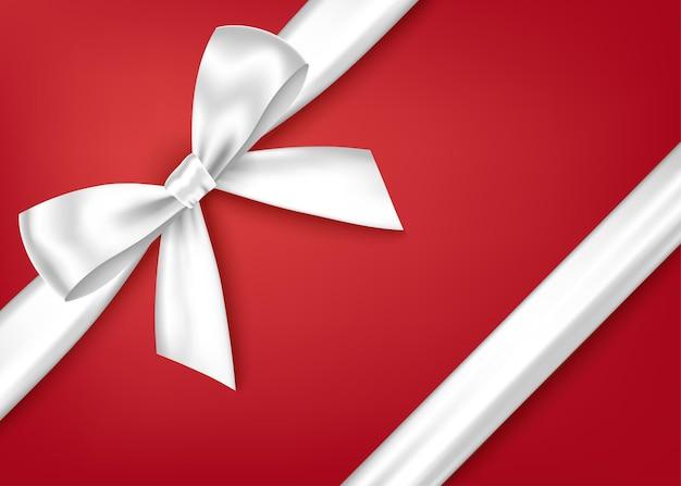 반짝이 흰색 장식 선물 리본과 코너 장식을위한 활. 프리미엄 벡터