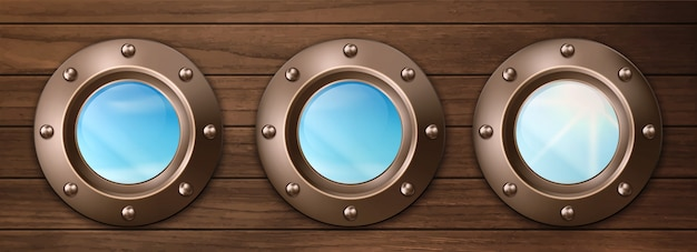 Ship portholes on wooden wall with sky view Free Vector