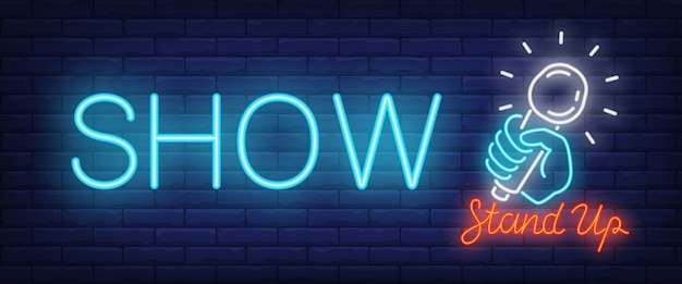 Show neon sign. glowing stand up text and hand with microphone Free Vector