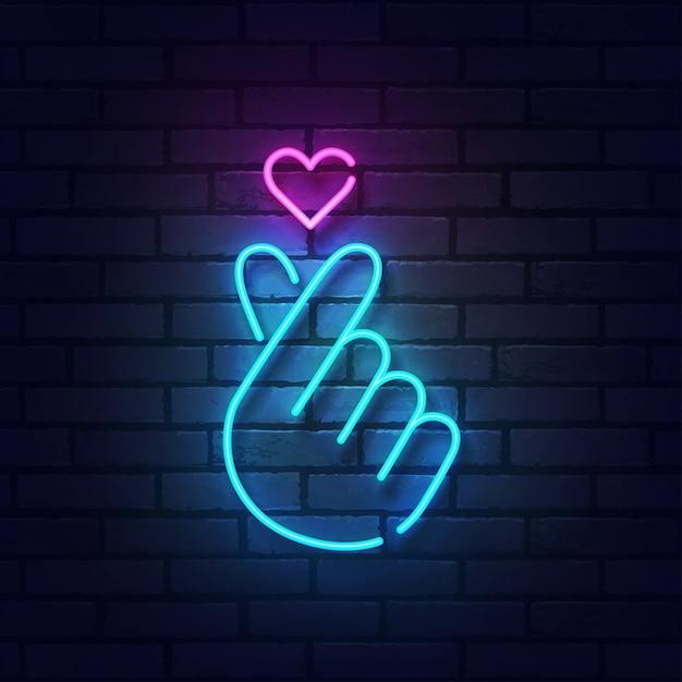 Знак сердца пальца с красочными неоновыми огнями изолированными на кирпичной стене. Premium векторы