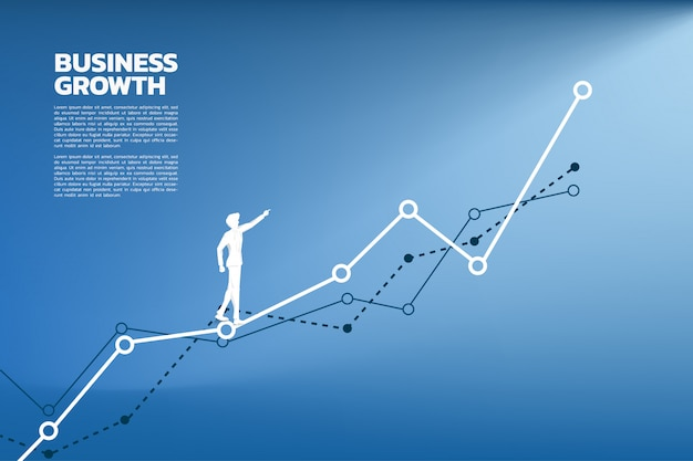 Silhouette of businessman point to higher of graph. Premium Vector