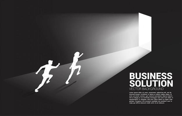 Silhouette of businessman running to exit door. Premium Vector