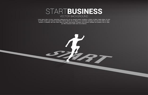 Silhouette of businessman running from start line. Premium Vector