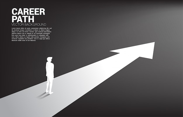 Silhouette of businessman standing on forward arrow. Premium Vector