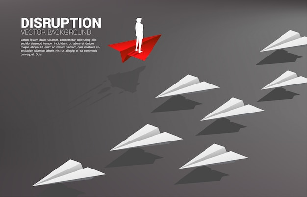 Silhouette of businessman standing on red origami paper airplane go different way from group of white. business concept of disruption and vision mission. Premium Vector
