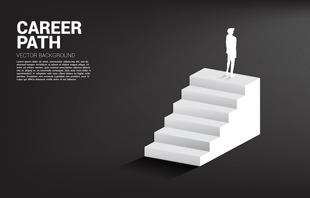 Silhouette of businessman standing on top of a stair Premium Vector