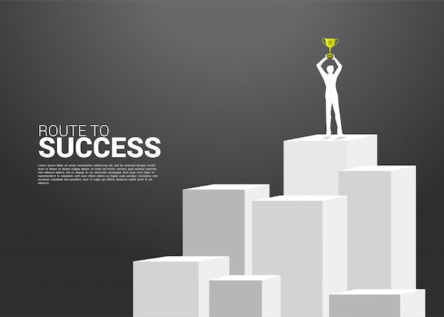 Silhouette of businessman with trophy on top of mountain. Premium Vector