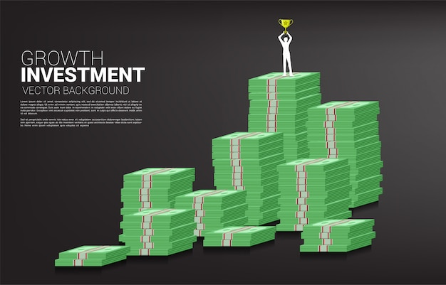 Silhouette of businessman with winner trophy standing on top of growth graph with stack of banknote. Premium Vector