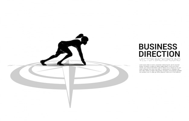 Silhouette of businesswoman ready to run from center of compass on floor.concept of career path and business direction Premium Vector