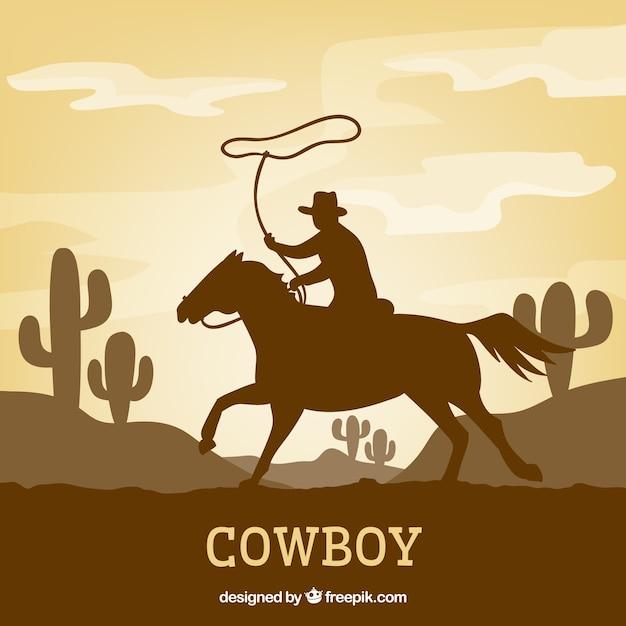 Silhouette of cowboy riding Premium Vector