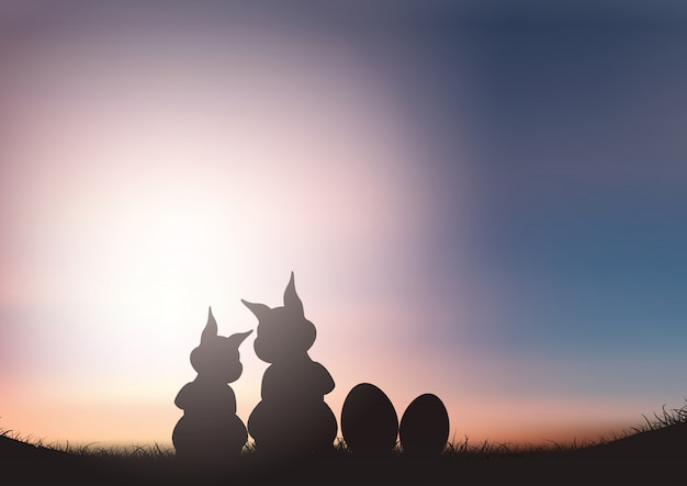 Silhouette of easter bunnies against a sunset sky Free Vector