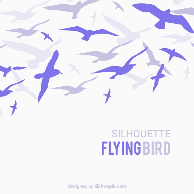 Silhouette flying bird background Free Vector